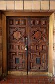 Door. Doors leading into a building poster