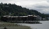 Coastal Homes On A Pier At Low Tide