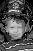 Young Boy Wearing Fireman's Hat
