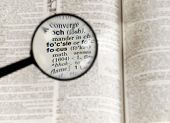 picture of verbs  - Magnifying Glass on the word FOCUS in the dictionary - JPG