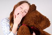 sleepy girl hugging bear