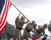 Re-enactment of Iwo Jima flag raising during veteran's parade