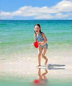 Happy girl having fun playing on beach