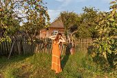 Teenager Young Woman In Vintage Sarafan Dress Is Standing Stretching Her Hands In A Rustic Apple Orc poster
