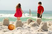 pic of children playing  - Young children playing at seashore - JPG