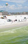 PENSACOLA BEACH - JUNE 23:  BP oil workers attempt to clean oil from the beach area on June 23, 2010 in Pensacola Beach, FL.