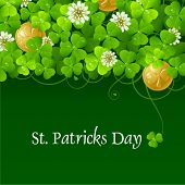 stock photo of saint patrick  - Clover glade and golden coins - JPG
