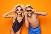 Happy Young Couple In Beachwear And On Color Background poster