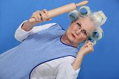 Angry old lady with rolling pin