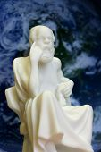 stock photo of socrates  - Socrates sitting on chair in loose robes against background of the earth - JPG