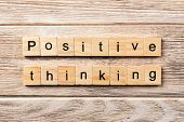 Positive Thinking Word Written On Wood Block. Positive Thinking Text On Table, Concept. poster