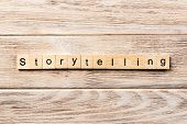 Storytelling Word Written On Wood Block. Storytelling Text On Table, Concept. poster