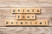 Unlock Your Potential Word Written On Wood Block. Unlock Your Potential Text On Table, Concept. poster