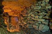 picture of catacombs  - The stone wall in the underground catacombs - JPG