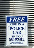 image of shoplifting  - humorous warning to shoplifters posted in a store window - JPG