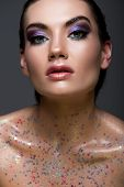 Attractive Glamorous Model Posing With Sparkles And Glitter On Naked Body, Isolated On Grey poster