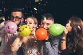 Blowing Balloons At New Years Party poster