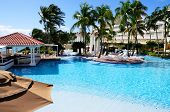 stock photo of conquistadors  - Chairs and umbrellas align the pool side at the El Conquistador Resort in Puerto Rico - JPG