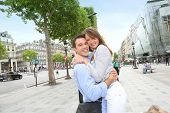 Couple embracing each other on the Champs Elysees Avenue