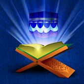 stock photo of quran sharif  - Beautiful View of Qaba or Kaaba Sharif on shiny rays background with open holy book Quran or Kuran Sharif - JPG