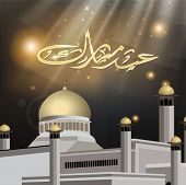 picture of kaba  - Arabic Islamic calligraphy of Eid Mubarak with Mosque and Masjid on shiny background - JPG