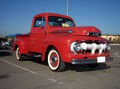 sweet classic red truck with blue sky.