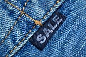 Blue jeans label with word SALE
