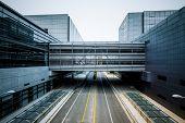 road go through the modern office building at shanghai airport.