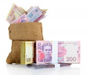 Burlap bag with Ukrainian money, isolated on white
