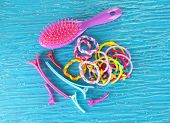 Scrunchies, hairbrush  and  hair - clip   on a blue background