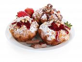 Tasty muffin cakes with strawberries and chocolate on plate, isolated on white