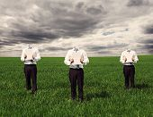 anonymous men in white shirt and black trousers holding empty sheets and standing on the green grass
