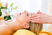 Wellness - woman receiving head or face massage in spa