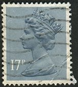 UK-CIRCA 1983:A stamp printed in UK shows image of Elizabeth II is the constitutional monarch of 16