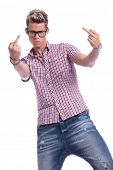casual young man showing his two middle fingers while looking angrily at the camera. on  white backg