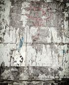 Grunge Background with Old Torn Posters.