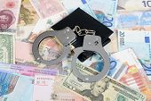 Currency from world with handcuffs and wallet