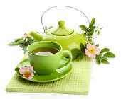 stock photo of dog-rose  - Cup and teapot of herbal tea with hip rose flowers - JPG
