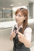 Asian business woman give you a gesture of fake, closeup portrait in outside of Taipei, Taiwan, Asia.