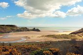 A view of Three Cliffs Bay on the Gower Peninsula in South Wales, UK