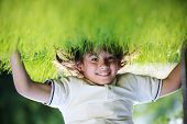 picture of upside  - Portraits of happy kids playing upside down outdoors in summer park walking on hands - JPG