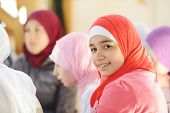 stock photo of muslimah  - Muslim and Arabic girls learning together in group - JPG
