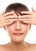 Eye massage. Skin care woman putting eye cream touching upper eyes. Facial beauty closeup of beautif