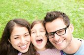 image of three life  - Young family of three outdoor being happy and cheerful - JPG