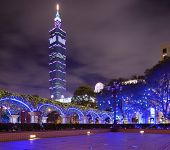 TAIPEI, TAIWAN - JANUARY 13: Taipei 101 stands tall above a small plaza January 13, 2013 in Taipei, TW. The building is currently the world's second tallest at a height of 509 meters.