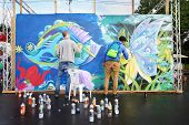MOSCOW - AUGUST 18: Participants of festival graffiti at festival Bright people in Gorky Park, on Au