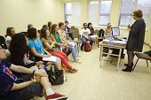 MOSCOW - AUGUST 18: Students listen to lecturer at Global Youth Voice - AIESEC International Congres