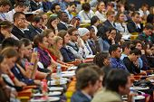 MOSCOW - AUG 20: Participants of  Global Youth to Business Forum listen to speaker in congress-hall