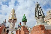 BARCELONA, SPAIN-MAY 12. The colorful mosaics chimneys made by broken ceramic tiles on the roof of P
