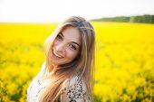Beautiful Young Woman Of Yellow Wildflowers
